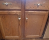 BEFORE -- worn, outdated cabinets