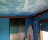Underwater ceiling mural with personalized surfboard